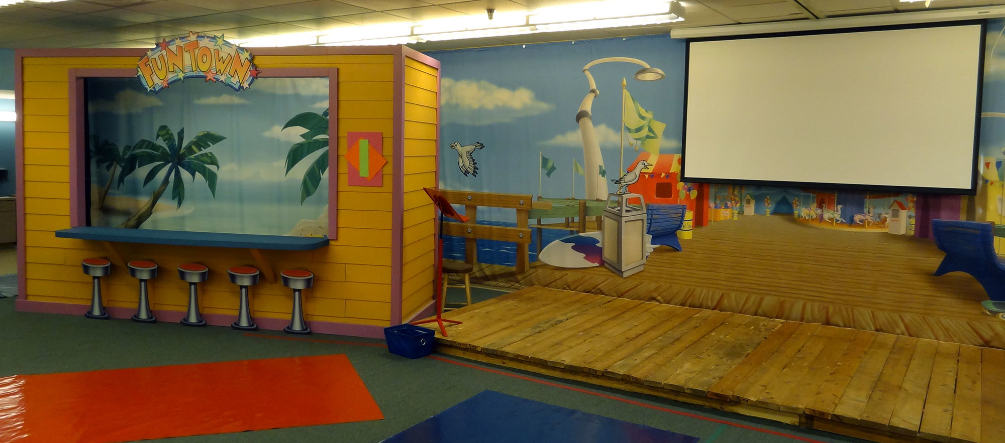 Beach and Boardwalk Stage Themed Environment at Casas Church