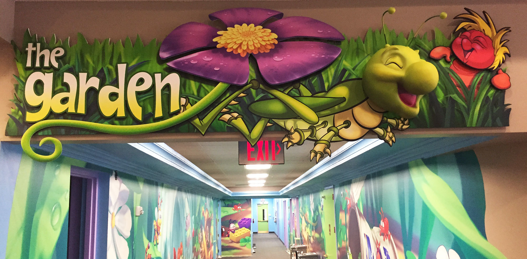 Bugs and Grasshopped Themed Wallcovering and Sign at Meadowbrook Church