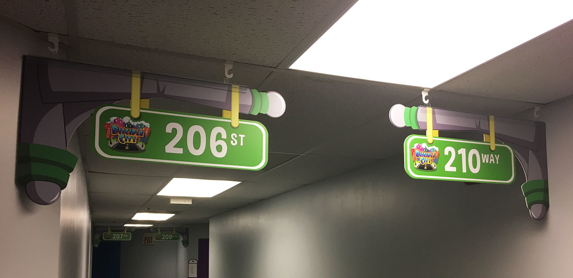 Example of 2D Classroom Room Number Signs in Big City Toon Town Theme